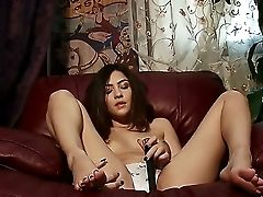 Sweet Dark Haired Stunner Cassie Laine Is Displaying Her Natural Smallish Boobies On Camera While Laying Down On Her Stool And Masturbating Using Only
